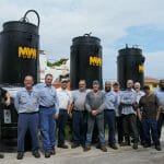 Workers near MWI pumps
