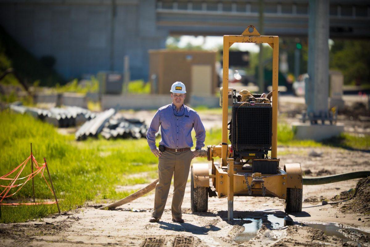 MWI worker posing with Primerite pump